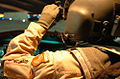 A CH-47 Chinook pilot adjusts his night vision goggles DVIDS14813.jpg