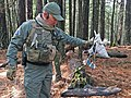 A Law Enforcement officer holds a drying rack (29804031264).jpg