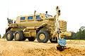 A U.S. Army Buffalo explosive device detection vehicle, assigned to 1221st Route Clearance Company, South Carolina Army National Guard, digs up an improvised explosive device (IED) during route clearance 140624-Z-XH297-029.jpg