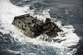 A U.S. Marine Corps assault amphibious vehicle prepares to enter the well deck of the amphibious assault ship USS Bonhomme Richard (LHD 6) in the East China Sea March 11, 2014 140311-N-LM312-248.jpg