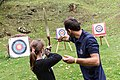 A child with an expert captured during archery activities at Dynamo Camp.jpg