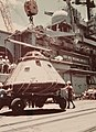 A crane lowers the Apollo CSM-111 capsule to the pier at Pearl Harbor after unloading it from USS New Orleans (LPH-11), 25 July 1975 (428-GX-K-109709).jpg