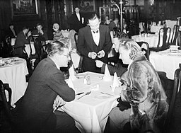 A group of diners give their order to the waiter at a restaurant in the West End of London, spring 1941. D2957