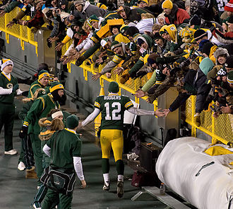 Aaron Rodgers - Rodgers greeting the fans in Lambeau Field during the 2010 season's finale against the Bears.