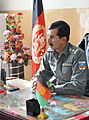 Afghan National Police 1st Lt. Sardar Hotak, the police chief of Shah Joy district, speaks with guests before a graduation ceremony for Afghan Local Police cadets at the district center in Zabul province 120129-N-CI175-033.jpg