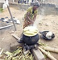 African Woman Cooking Maize For Sale.jpg