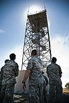 Airman stand in front of radar tower 120626-F-BH656-023.jpg