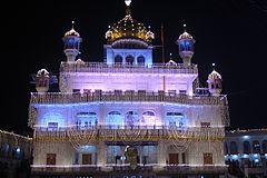 Akal Takht illuminated, in Harmandir Sahib complex, Amritsar.jpg