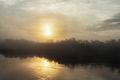Amanecer bajo la niebla en Boca de Autana.jpg