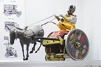 Antique wind-up tin toy clown with bucking mule (25503676180).jpg