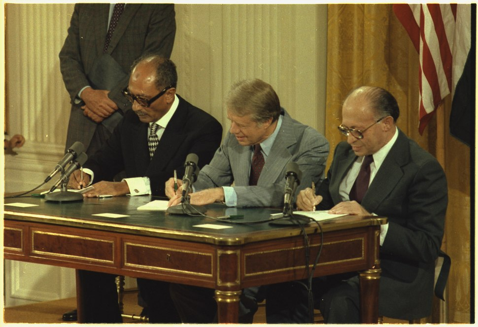 Anwar Sadat, Jimmy Carter and Menahem Begin at the Camp David Accords Signing Ceremony. - NARA - 181392