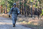 Army Sgt. Jesus Fernandez, a forward observer with 2nd Battalion, 325th Airborne Infantry Regiment, 2nd Brigade Combat Team, 82nd Airborne Division, walks along a trail during the land navigation portion of 121114-A-FO214-388.jpg