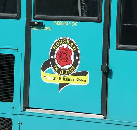 An emblem on the side of an Arriva bus celebrating Horsham's win of the Britain in Bloom contest. Arriva Guildford & West Surrey 3082 emblem.JPG