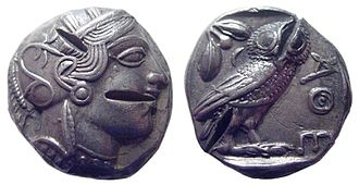 Counterfeit money - A tetradrachm from Ancient Athens, dated circa 449-413 BC. Contains multiple 'test cuts' which were commonly made by suspicious minds in antiquity to detect forgeries by assessing whether the base metal underneath was the same (silver) or a cheaper metal (e.g. bronze). This coin has silver beneath and is not an ancient forgery.