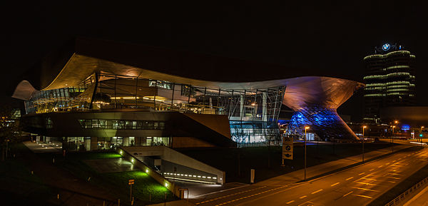 Night view of the BMW Welt with the BMW Tower in the background, Munich, Germany
