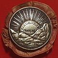 Badge of the French Workers Party (Parti Ouvrier Francais) 1893-1905.jpg
