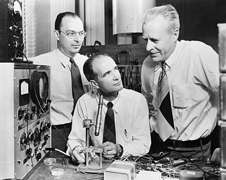 John Bardeen, William Shockley and Walter Brattain developed the bipolar point-contact transistor in 1947. Bardeen Shockley Brattain 1948.JPG