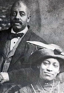 A black and white image (c.1912) of two well-dressed people in their early 20s to late 30s.