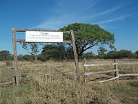 Big entry sign to Km 75 Ruins.JPG