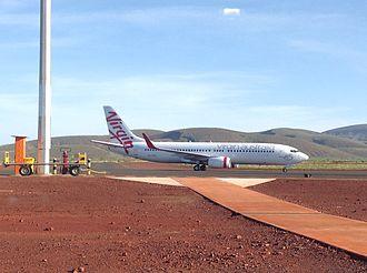 Boolgeeda Airport - A Virgin Australia charter flight arriving at Boolgeeda.