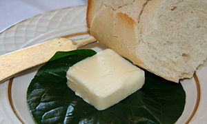 Butter - Butter is often served for spreading on bread with a butter knife.