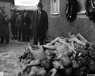Buchenwald concentration camp - US Senator Alben W. Barkley (D-Kentucky) looks on after Buchenwald's liberation. Barkley later became Vice President of the United States under Harry S. Truman
