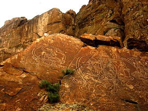 Rock art - Buddhist stone carvings at Ili River, Kazakhstan.
