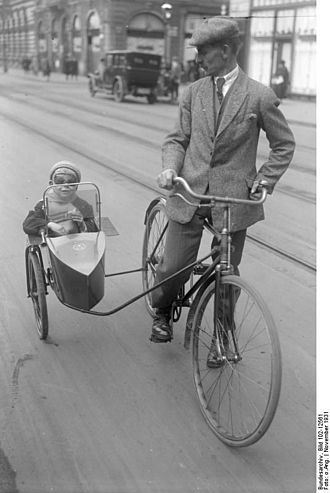 Sidecar - German bicycle sidecar carrying a child, 1931