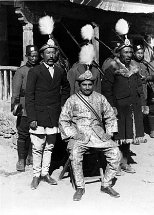 Pahari people - Major Hiranya Bista (seated) with Tibetan guards, a Pahari civil servant of Chhetri caste