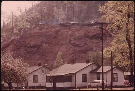 Coal slag heap burns above company houses near Hutchinson, 1974 COAL SLAG HEAP BURNS ABOVE COMPANY HOUSES NEAR HUTCHINSON WEST VIRGINIA, NEAR LOGAN, IN THE SOUTHERN PART OF THE... - NARA - 556416.jpg