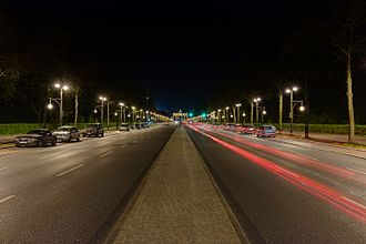 Straße des 17. Juni - View by night with the Brandenburger Tor in the back.