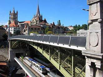 Lausanne - The Charles-Bessières bridge with Lausanne Metro car. In the background the cathedral of Notre-Dame and the old town.