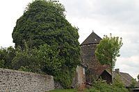 Château d'Escorailles - Tour Nord-Ouest ouverte de lierre.JPG