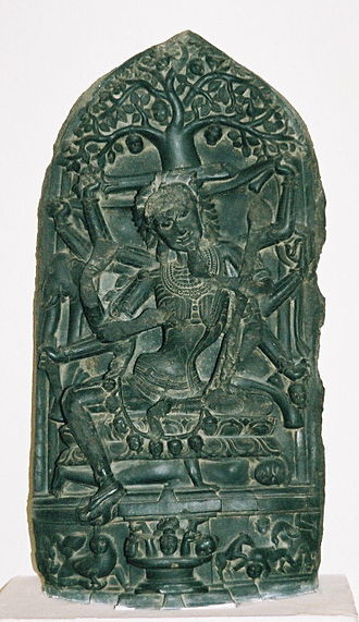 Chamunda - Chamunda, 11th-12th century, National Museum, Delhi. The ten-armed Chamunda is seated on a corpse, wearing a necklace of severed heads.