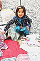 Chitter-chatter of young children fill the air as New Kabul Compound, Afghan Women's Bazaar springs to life 131023-A-WQ129-008.jpg