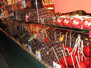 Chocolate-covered fruit - A booth selling caramel apples and chocolate-covered fruit at the Christkindlmarkt in Salzburg, Austria