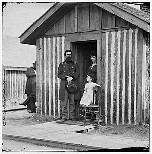 John Aaron Rawlins - General Rawlins at his quarters in City Point, Virginia with his second wife, Mary Hurlburt, and his child.