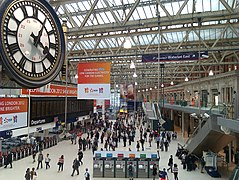 Clock and view over concourse, Waterloo Station, London.jpg
