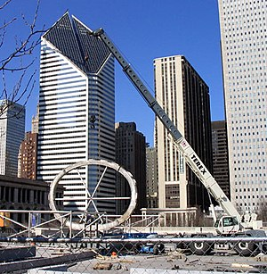 Cloud Gate - The first of two internal support rings for the sculpture is erected in Millennium Park at AT&T Plaza.