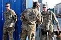Command Sgt. Maj. Lambert presents coins to military working dog demonstrators DVIDS484870.jpg
