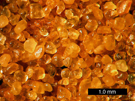 Sand from Coral Pink Sand Dunes State Park, Utah. These are grains of quartz with a hematite coating providing the orange colour. Scale bar is 1.0 mm. CoralPinkSandDunesSand.JPG