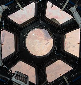 Cupola ISS open shutters middle crop.jpg