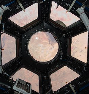 Cupola (ISS module) - The Sahara viewed through the Cupola with its shutters open.