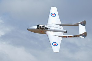 De Havilland DH115 Vampire banking with the sun reflecting off its silver wings.jpg