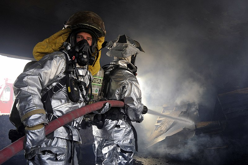 File:Defense.gov News Photo 100809-F-6188A-164 - Firefighters from the 447th Expeditionary Civil Engineer Squadron extinguish a fire in a training room during live-burn training at Baghdad.jpg