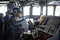 Defense.gov News Photo 101007-N-8335D-006 - U.S. Navy Seaman Rachel Mackey steers the amphibious dock landing ship USS Harpers Ferry LSD 49 through the Philippine Sea while forward deployed.jpg