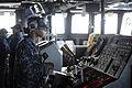 Defense.gov News Photo 101007-N-8335D-006 - U.S. Navy Seaman Rachel Mackey steers the amphibious dock landing ship USS Harpers Ferry LSD 49 through the Philippine Sea while forward deployed.jpg