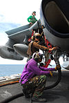 Defense.gov News Photo 110811-N-AW206-041 - Airman Raymond Burrell and Airman Thomas Robertson fuel an EA-6B Prowler assigned to Electronic Attack Squadron 136 aboard the nuclear-powered.jpg