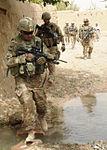 Defense.gov News Photo 110813-F-SA682-004 - U.S. Army Sgt. 1st Class John Shimkus left a platoon sergeant with the Kandahar Provincial Reconstruction Team crosses a creek during a.jpg