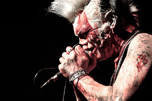 Psychobilly - Demented Are Go's singer's stage blood make-up is an example of the horror-film schtick some psychobilly bands adopted.